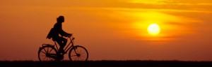 woman-biking-in-sun