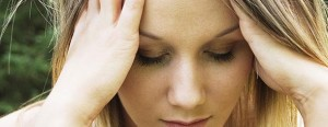 girl-holding-head-in-pain-health-stress-chiropractic