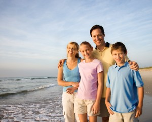 family-smiling-on-beach-ottawa-health