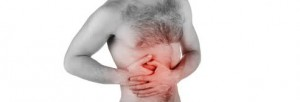 man-holding-side-pain-pancreas-health