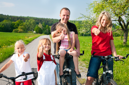 Active family thumbs up