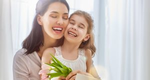 stockfresh 8003943 daughter congratulates mom sizeM 1